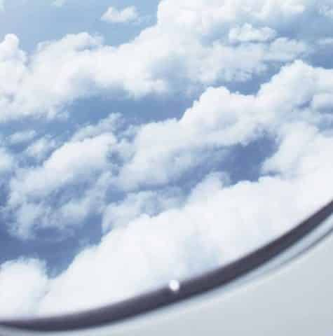 view out of aeroplane window of clouds